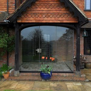 Farnham porch with curved glass