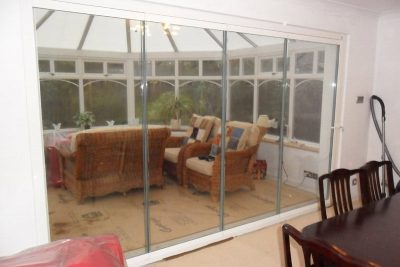 Frameless glass doors for conservatories