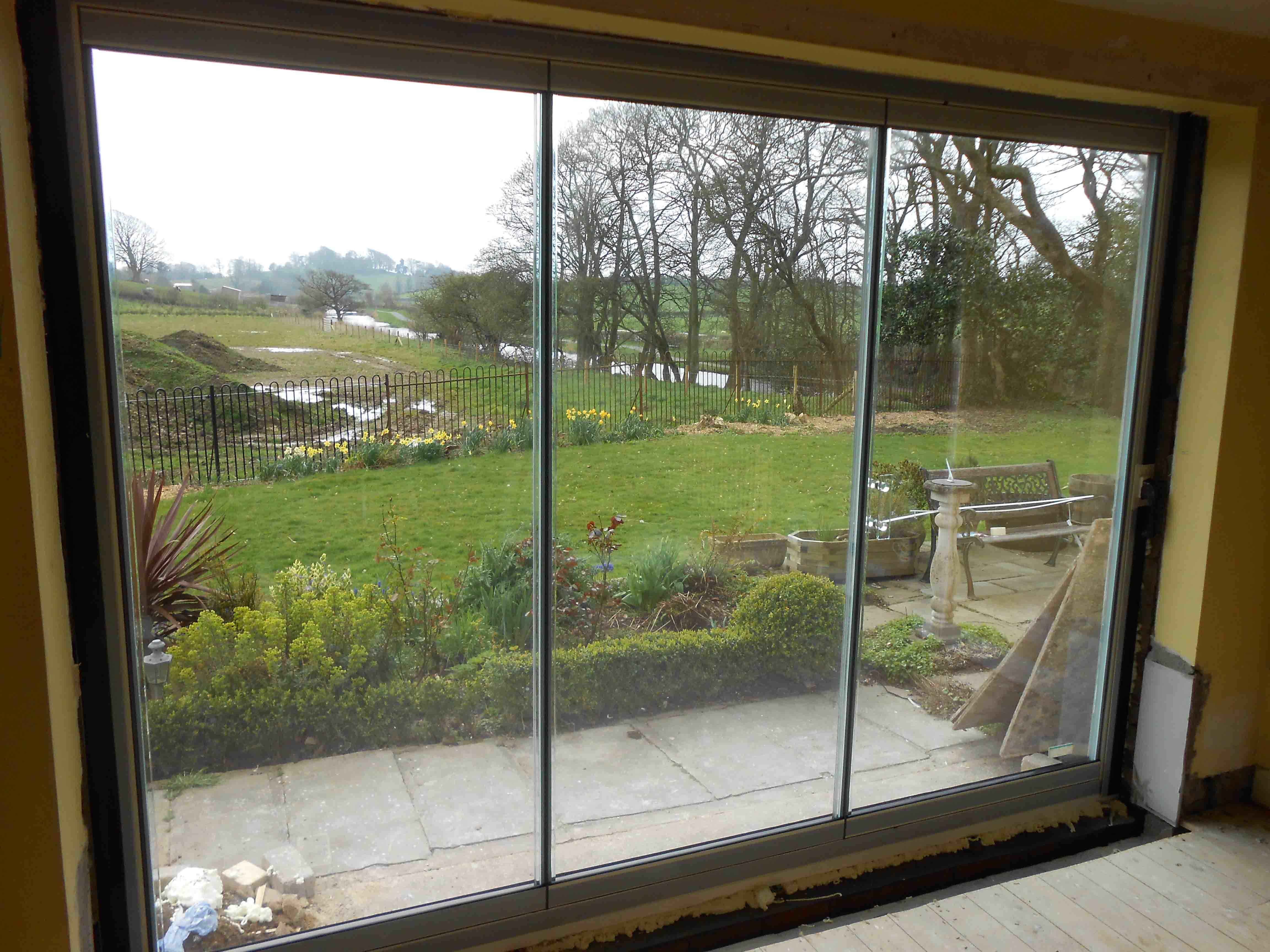 How frameless bifolds look better fgc for Double glazed patio doors