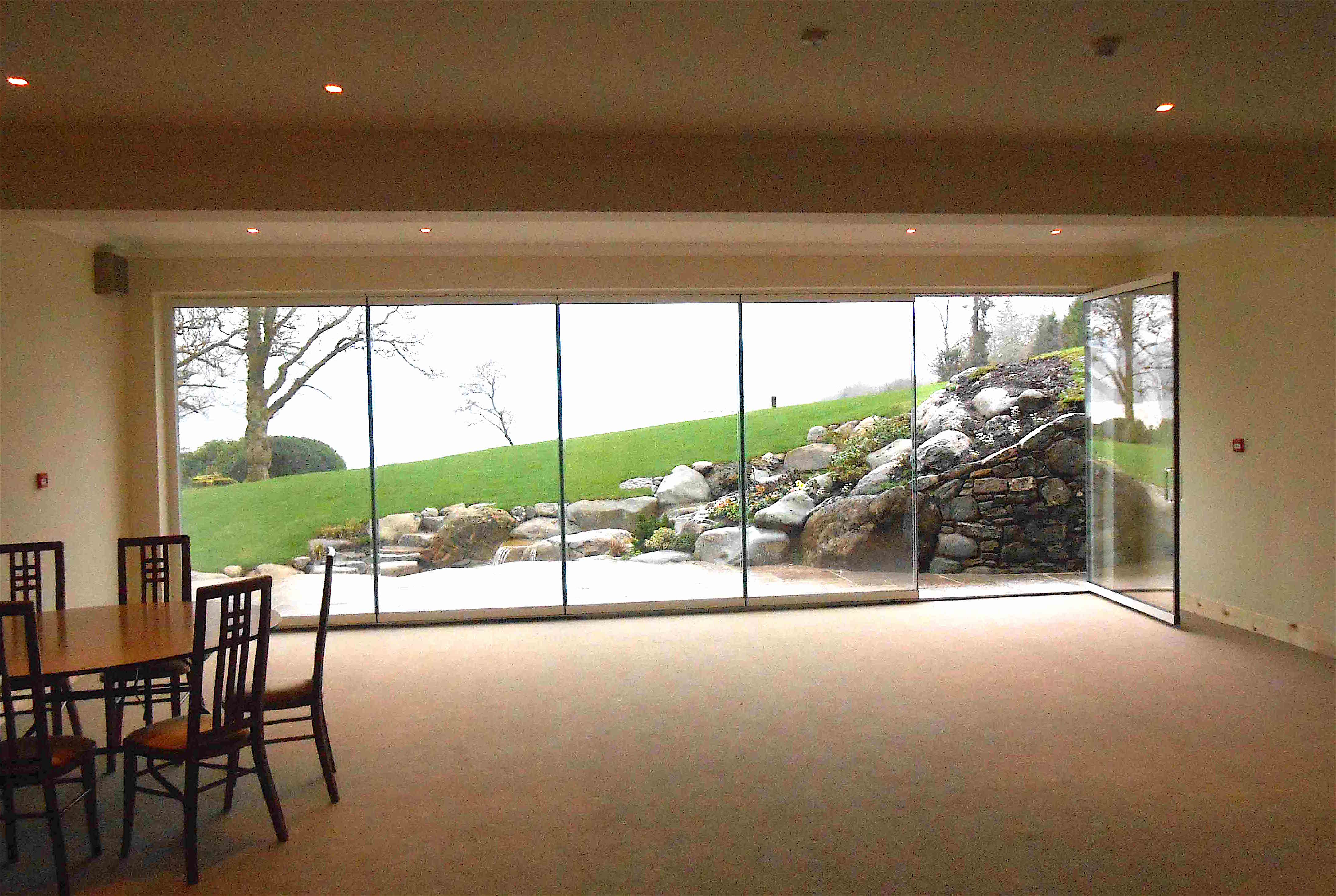 Frameless bifolding doors fgc Folding patio glass doors