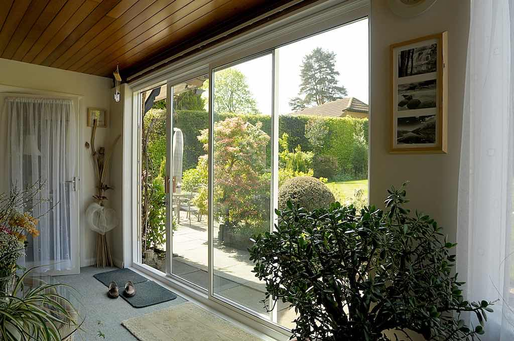 Sliding patio doors or frameless bifolding doors fgc for Patio doors uk