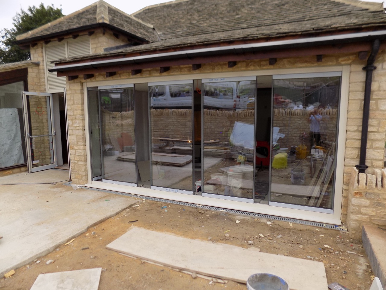 How frameless bifold doors open and close?