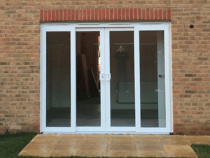 Frameless slide and fold doors in a new build home fgc for Pvcu patio doors