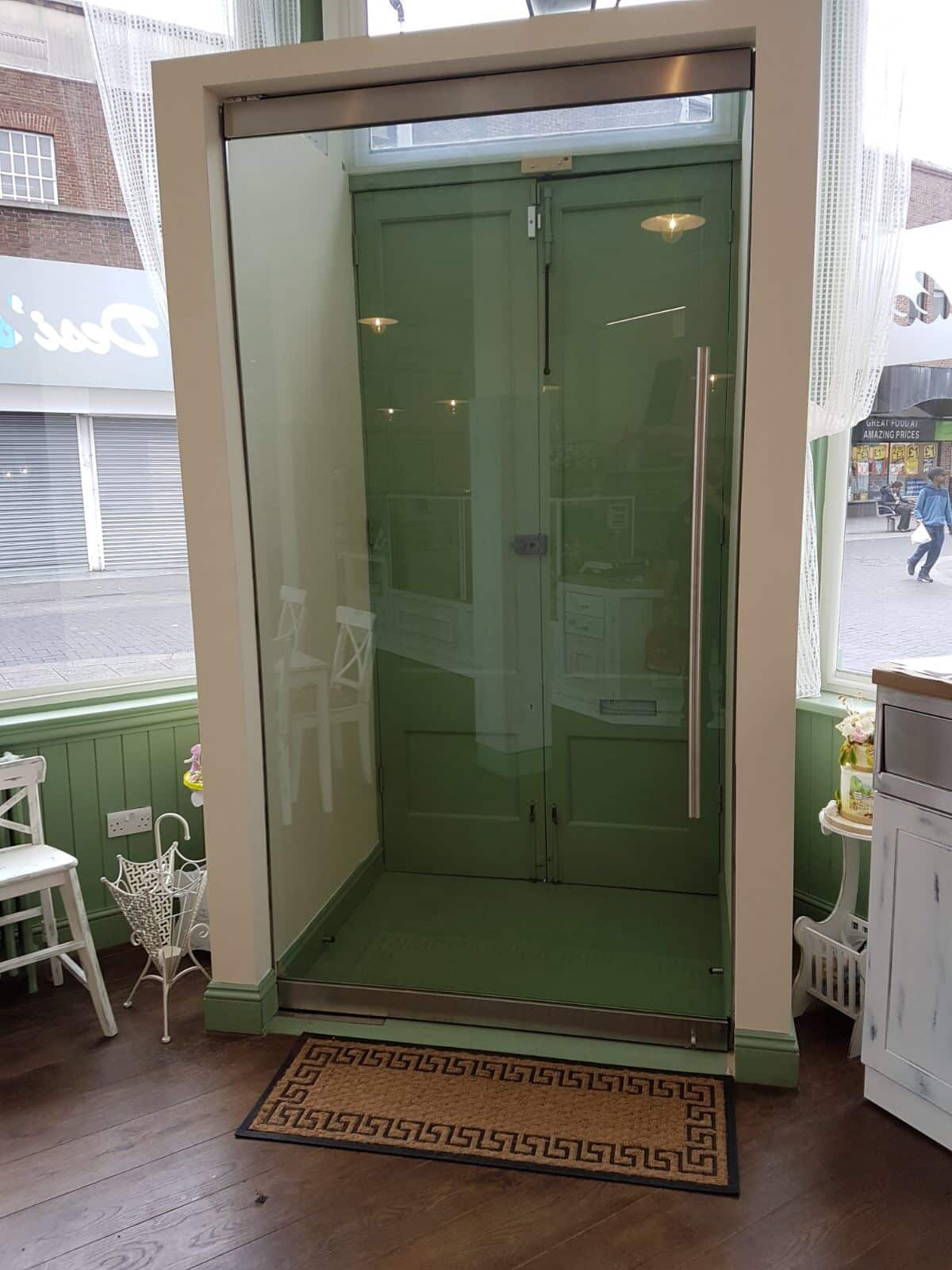 Internal shop frameless porch door