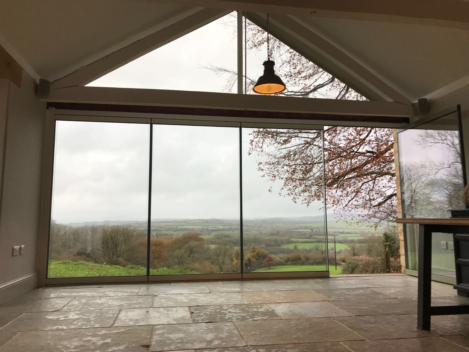 Beaminster Frameless doors & gable window image 3