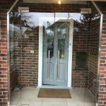 Glass porch and shaped window, Surrey.