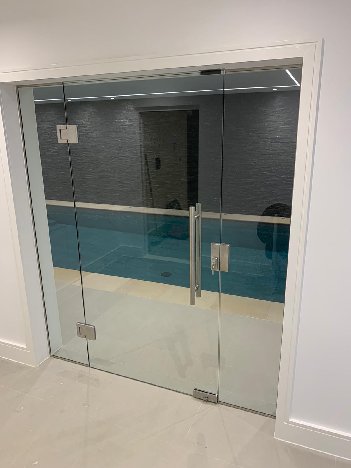 Swimming pool internal glass doors
